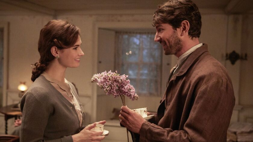 """Lily James and Michael Huisman in """"The Guernsey Literary and Potato Peel Pie Society"""""""