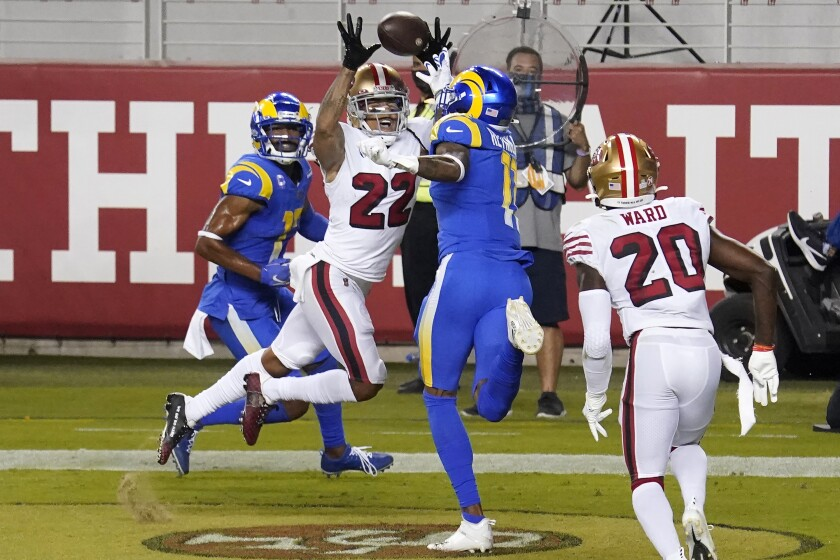 San Francisco's Jason Verrett (22) intercepts a pass in the end zone between Rams  Robert Woods, left, and Josh Reynolds.