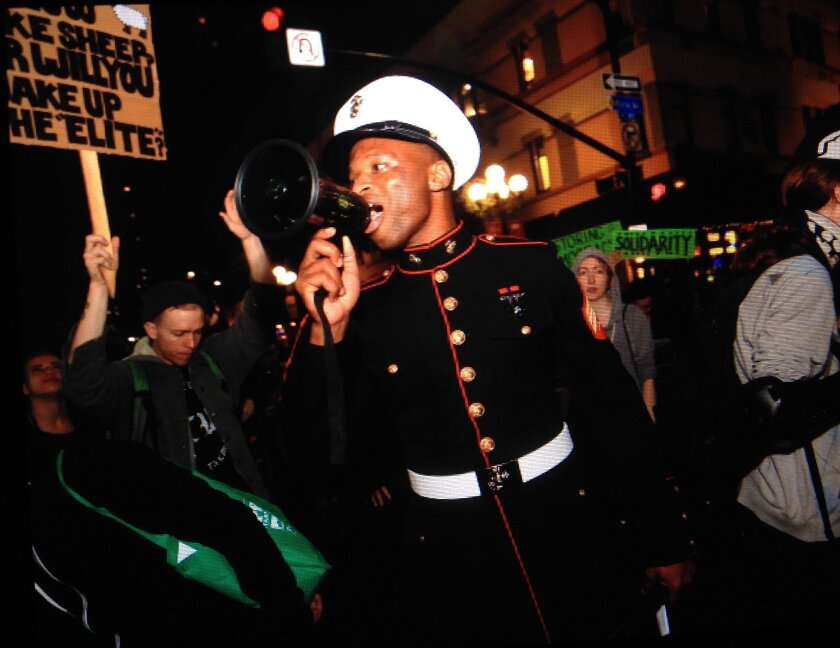 Mark Jones led a protest from the convention center to Horton Plaza. He said he is a former U.S. Marine.