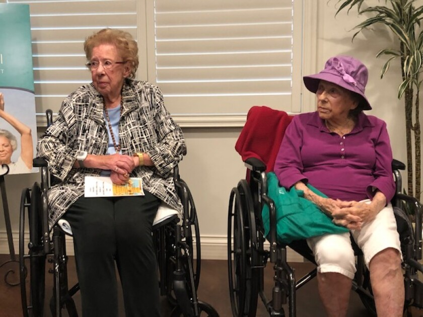 Captain Georgia McKearly and Evelyn Murray share stories Sept. 22, 2019 for a National Centenarian Day event held at the senior living community, Vi at La Jolla Village.