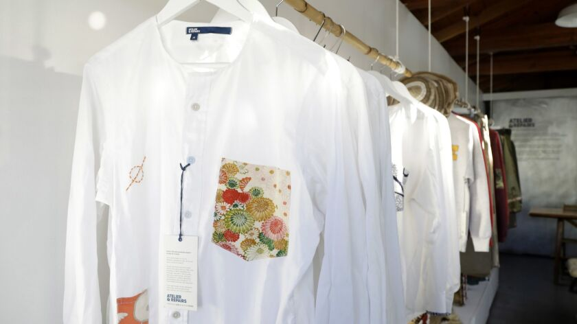 A rack of clothing inside the Atelier & Repairs store, where throwaways get a new life.