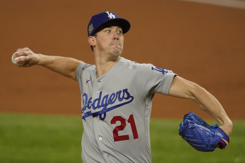 Walker Buehler winds up to pitch