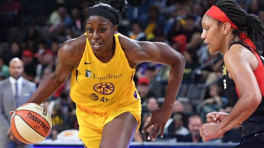 The Sparks' Chiney Ogwumike drives against the Aces' A'ja Wilson on May 26, 2019, in Las Vegas.