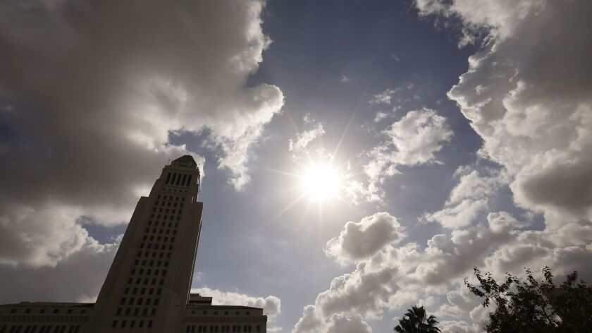 Clouds hover over Los Angeles City Hall in Los Angeles, Calif. on Feb. 12.