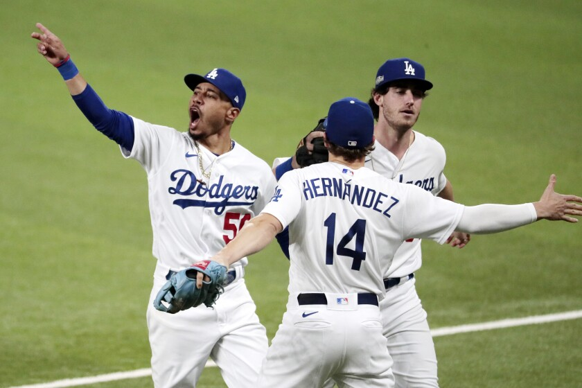 Dodgers right fielder Mookie Betts gestures goodbye to the San Diego Padres.