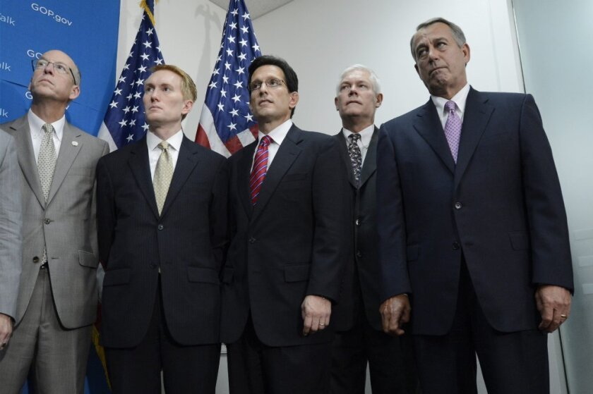 House Speaker John Boehner (R-Ohio) attends a news conference on Friday with his GOP colleagues, from left, Greg Walden, James Lankford, House Majority Leader Eric Cantor and Pete Sessions.