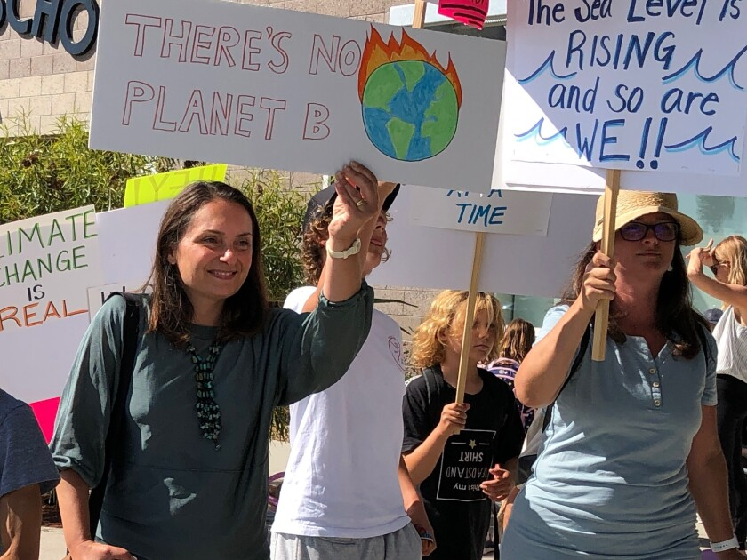 Residents gathered at the Solana Beach Library Sept. 20 to participate in the worldwide climate strike.