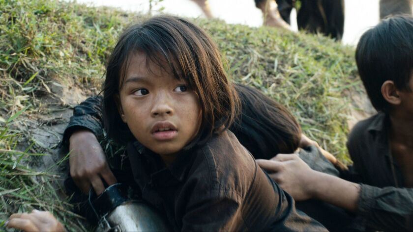 """Sareum Srey Moch in a scene from """"First They Killed My Father: A Daughter of Cambodia Remembers."""""""