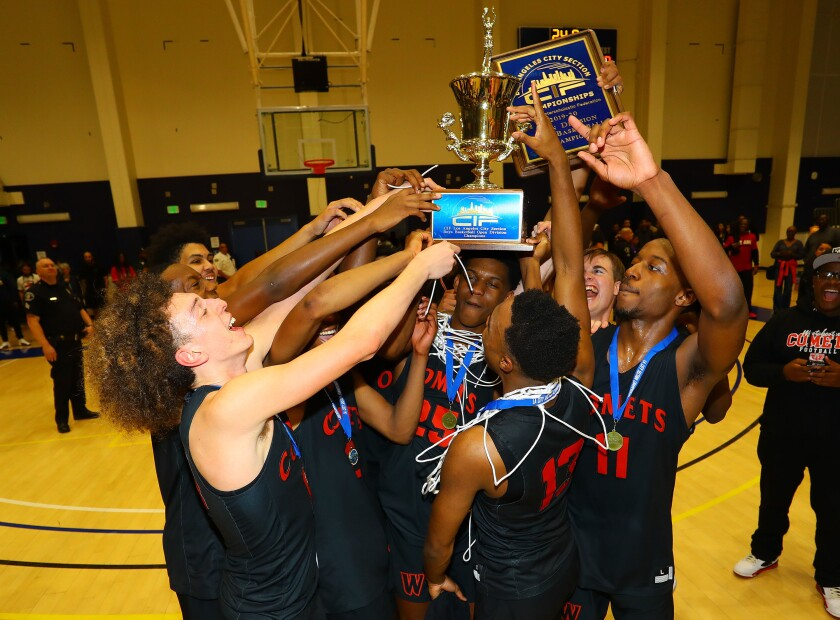 Westchester players celebrate their 68-43 win over Fairfax in the City Section Open Division title game Feb. 29, 2020.