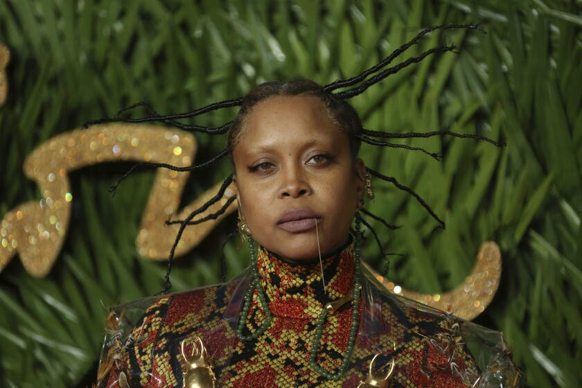 Singer Erykah Badu poses upon arrival at The British Fashion Awards 2017 in London, Monday, Dec. 4th, 2017.