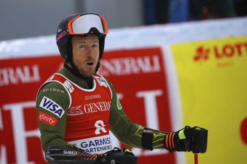 FILE - United States' Ted Ligety celebrates at the finish area of an alpine ski, men's World Cup giant slalom, in Garmisch Partenkirchen, Germany, in this Sunday, Feb. 2, 2020, file photo. Two-time Olympic champion Ted Ligety says he will retire from World Cup ski racing after the world championships. Ligety's final race will be the giant slalom on Feb. 19 in Cortina d'Ampezzo, Italy. (AP Photo/Marco Trovati, File)