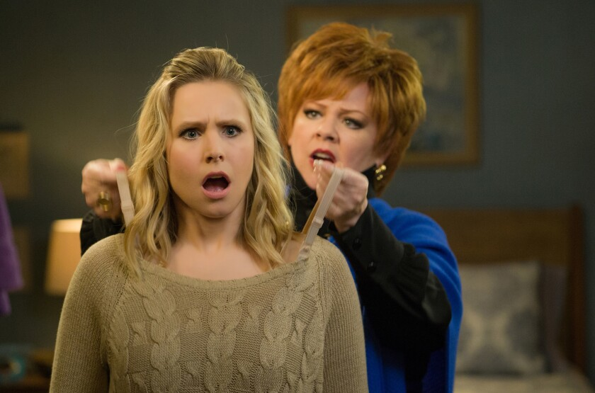 """Kristen Bell gets some tough-love fashion advice from Melissa McCarthy in a scene from """"The Boss."""""""