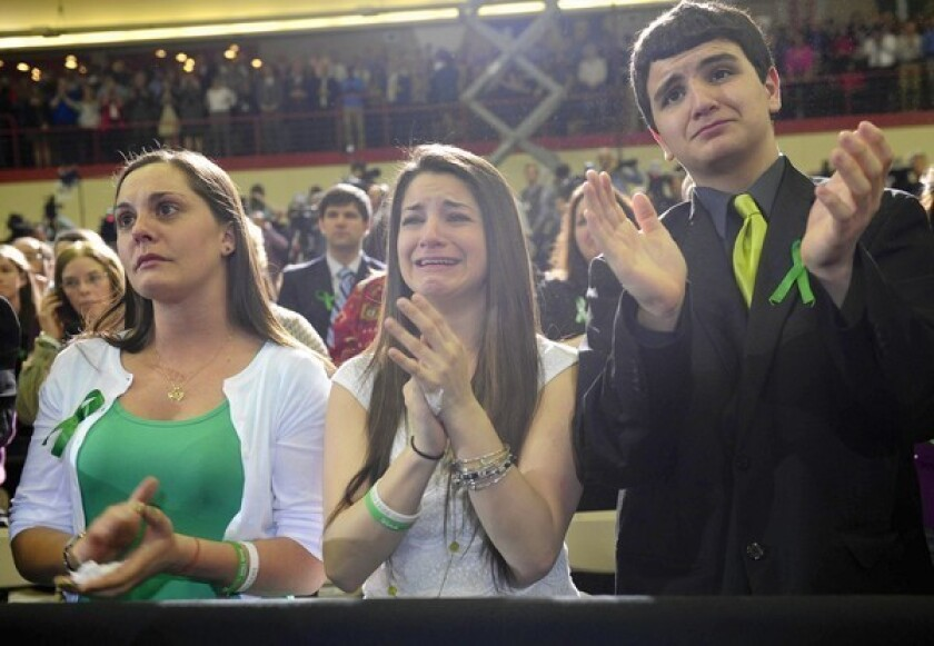 Karlee Soto, center, whose sister Victoria Soto was killed in the school shooting in Newtown, Conn., listens to President Obama speak at the University of Hartford.