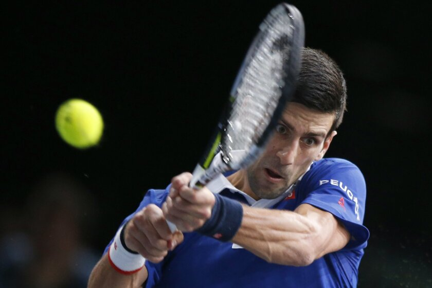 Novak Djokovic of Serbia returns the ball to Tomas Berdych of Czech Republic during their quarterfinal match of the BNP Masters tennis tournament, at Bercy Arena, in Paris, France, Friday, Nov. 6, 2015. (AP Photo/Francois Mori)