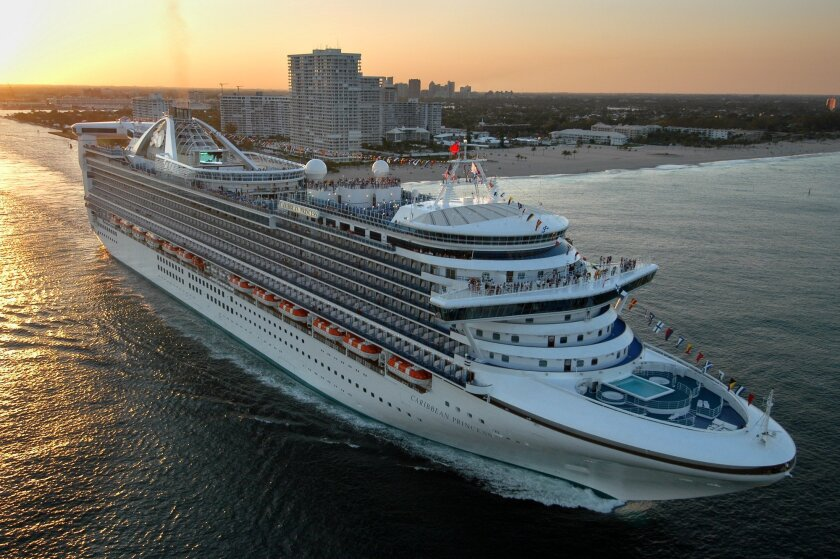 FILE - The new Caribbean Princess departs on its maiden voyage from Port Everglades in Fort Lauderdale, Fla., in this April 3, 2004 file photo. Federal health officials are investigating after an outbreak of illness has caused Caribbean Princess cruise ship to ends its trip early and returned to po