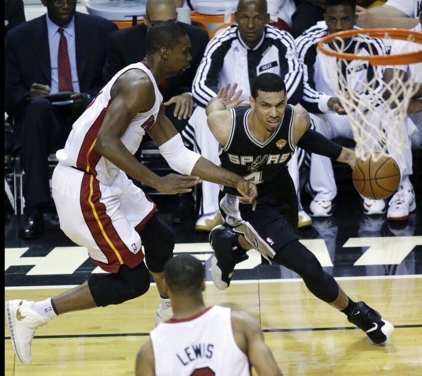 San Antonio Spurs guard Danny Green (4) drives around Miami Heat center Chris Bosh (1) in the first half in Game 4 of the NBA basketball finals, Thursday, June 12, 2014, in Miami. (AP Photo/Wilfredo Lee)
