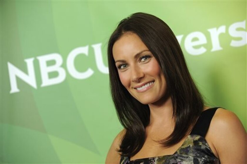 """FILE - This July 24, 2012 file photo shows actress Laura Benanti at NBCUniversal's 2012 Summer Press Tour in Beverly Hills, Calif. Benanti stars opposite Matthew Perry in NBC's """"Go On"""" and has a recurring role on USA's """"Royal Pains."""" (Photo by Jordan Strauss/Invision/AP)"""