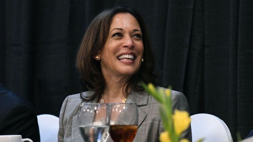 Democratic presidential candidate Kamala Harris smiles before giving a keynote address at a banquet
