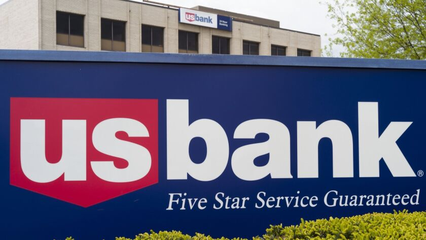 FILE- This May 3, 2017, file photo shows a U.S. Bank branch in Omaha, Neb. U.S. Bancorp said Thursda