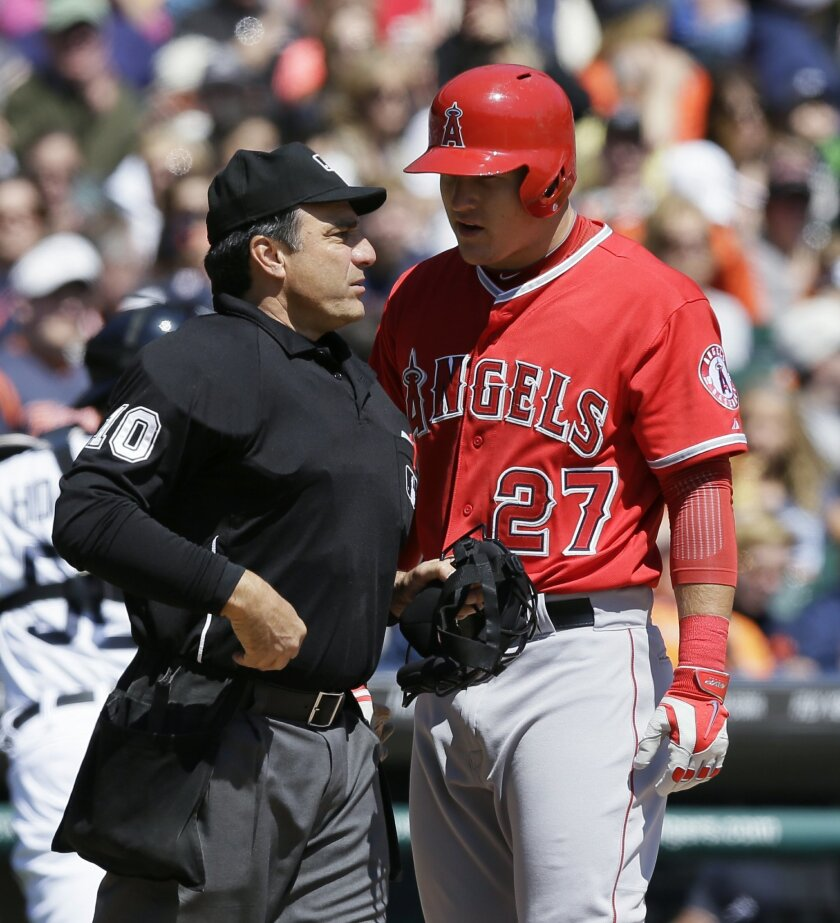 Los Angeles Angels' Mike Trout talks with umpire Phil Cuzzi after getting called out on strikes during the third inning of a baseball game against the Detroit Tigers in Detroit, Saturday, April 19, 2014. (AP Photo/Carlos Osorio)