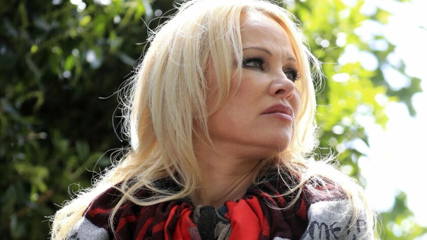 US actress Pamela Anderson speaks to the media outside Belmarsh Prison in south-east London, after v