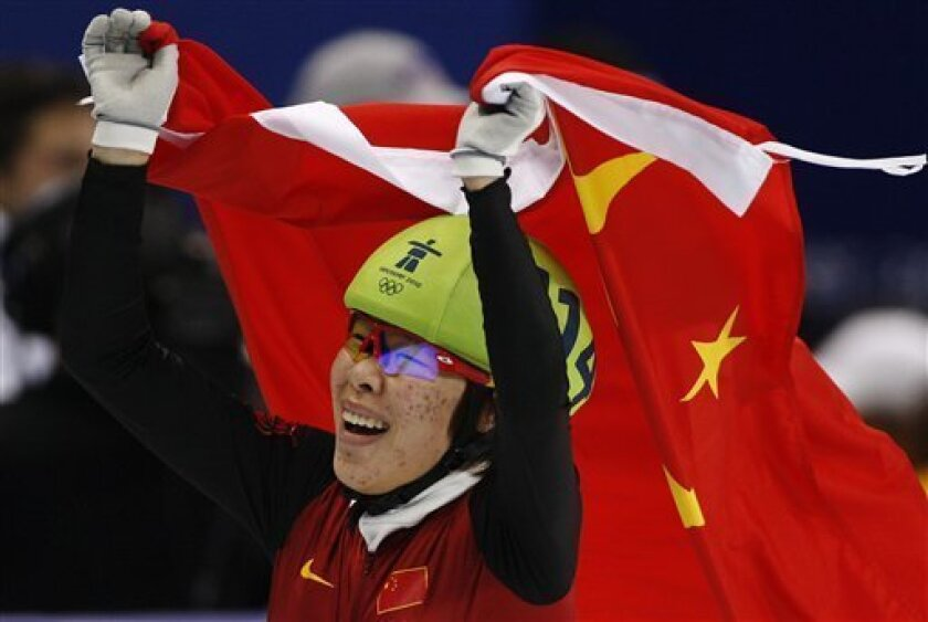 FILE - In this Saturday, Feb. 20, 2010 file photo, China's Zhou Yang reacts after winning the gold medal for the women's 1500m short track skating competition at the Vancouver 2010 Olympics in Vancouver, British Columbia. It was a political gaffe for Chinese short track speedskater Zhou Yang _ failing to thank her country and its government after her gold medal win at the Vancouver Olympics. But the 18-year-old is winning widespread support for her honesty and naivete, after being critizied by a top sports official this week for mentioning her parents in a post-win interview but failing to express gratitude for the Chinese sports system. (AP Photo/Ivan Sekretarev, File)