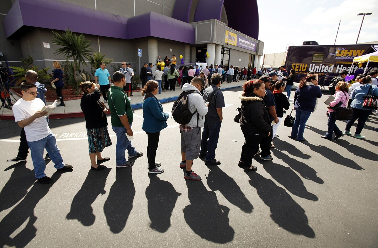"""People wait to sign up for healthcare coverage through the Affordable Care Act during a 19-hour """"Enroll-a-thon'' at the offices of SEIU-United Healthcare Workers West in Commerce. They were trying to beat the March 31 deadline. People started lining up at 5 a.m."""