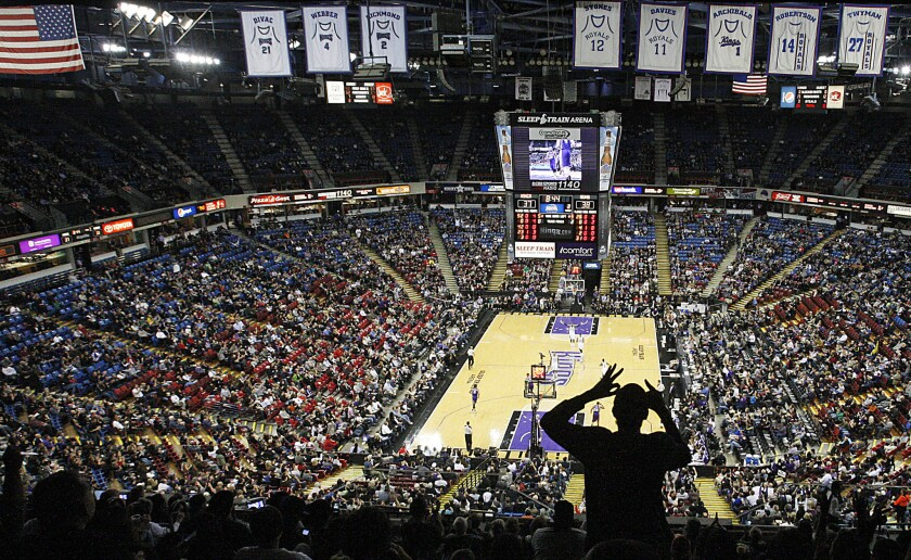 A fan cheers a three-point shot by the Sacramento Kings during a home game against the Phoenix Suns at the Sleep Train Arena.