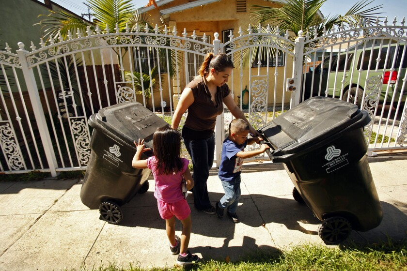 Crystal Garcia, 26, with her children Melonie, 4, left and Jesse, 3, right, is concerned about soil testing in the yards of neighbors that showed elevated levels of lead in their Boyle Heights neighborhood on March 12, 2014.