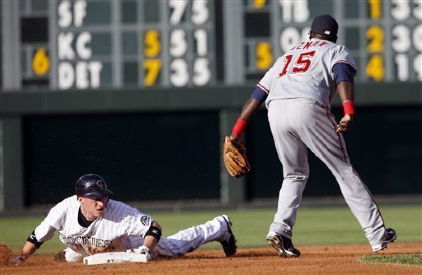 Colorado Rockies' Clint Barmes, left, steals second base as Washington Nationals shortstop Cristian Guzman fields the throw in the first inning of a baseball game in Denver on Tuesday, July 7, 2009. (AP Photo/David Zalubowski)