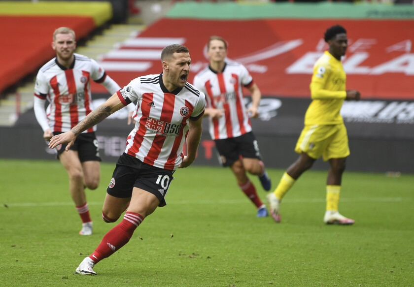 Sheffield United's Billy Sharp celebrates after scoring his side's opening goal from the penalty spot during the English Premier League soccer match between Sheffield United and Fulham at Bramall Lane stadium in Sheffield, England, Sunday, Oct. 18, 2020. (Gareth Copley/Pool via AP)