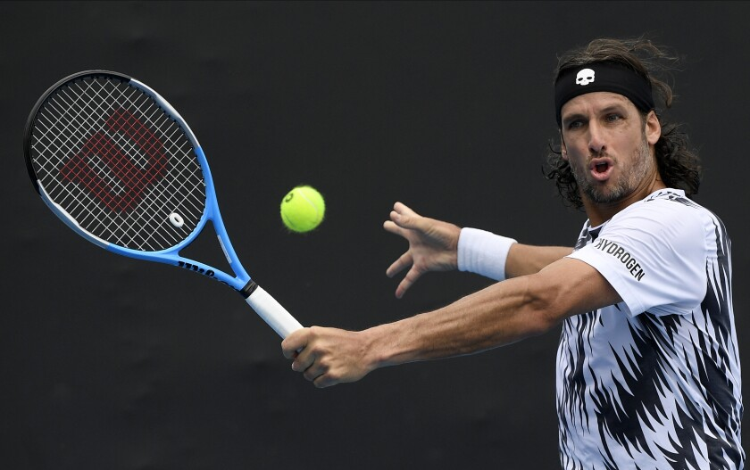 Spain's Feliciano Lopez makes a backhand return to Italy's Lorenzo Sonego during their second round match at the Australian Open tennis championship in Melbourne, Australia, Thursday, Feb. 11, 2021.(AP Photo/Andy Brownbill)