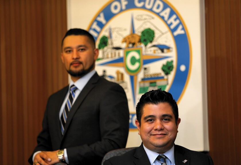 """""""Technology is playing a critical role not just for us millennials but Latinos in general,"""" said Cudahy Vice Mayor Christian Hernandez, 26, left. With him is Mayor Cristian Markovich, 29."""