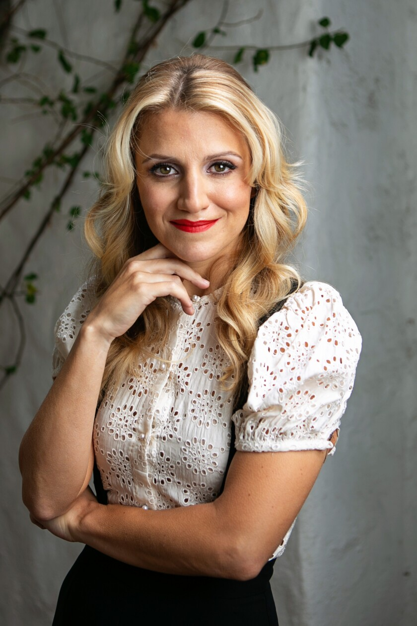 Annaleigh Ashford, wearing a white top, at her home in Los Angeles.