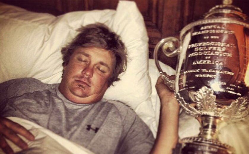 Jason Dufner loves his new trophy.