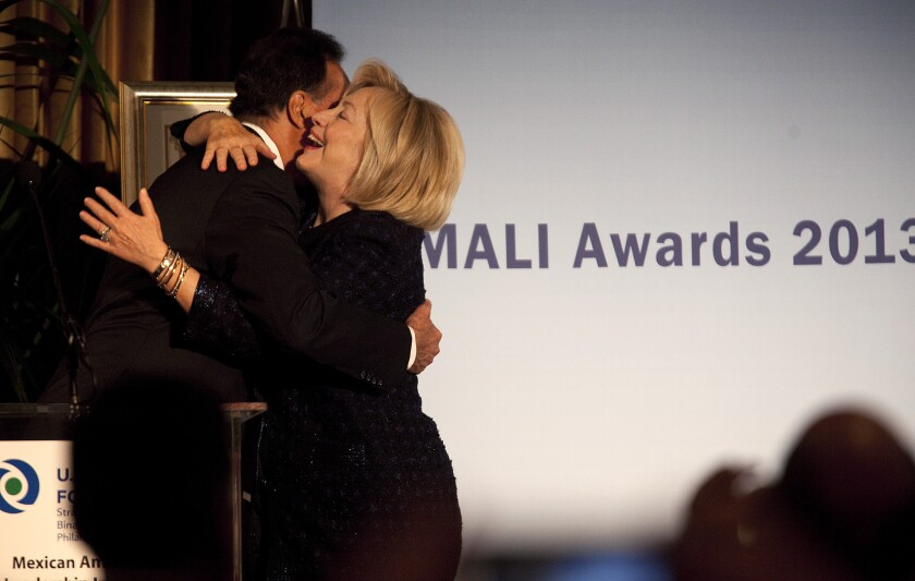 Hillary Rodham Clinton embraces Henry Cisneros, former U.S. secretary of Housing and Urban Development, after he introduced her at a brunch benefiting the Mexican-American Leadership Initiative at USC.