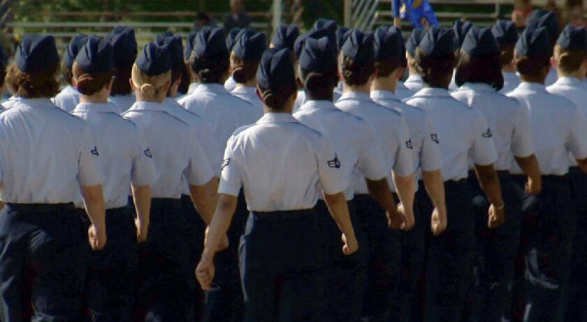 Female trainees march during graduation at Lackland Air Force Base in San Antonio, where a sex scandal continues to unfold.