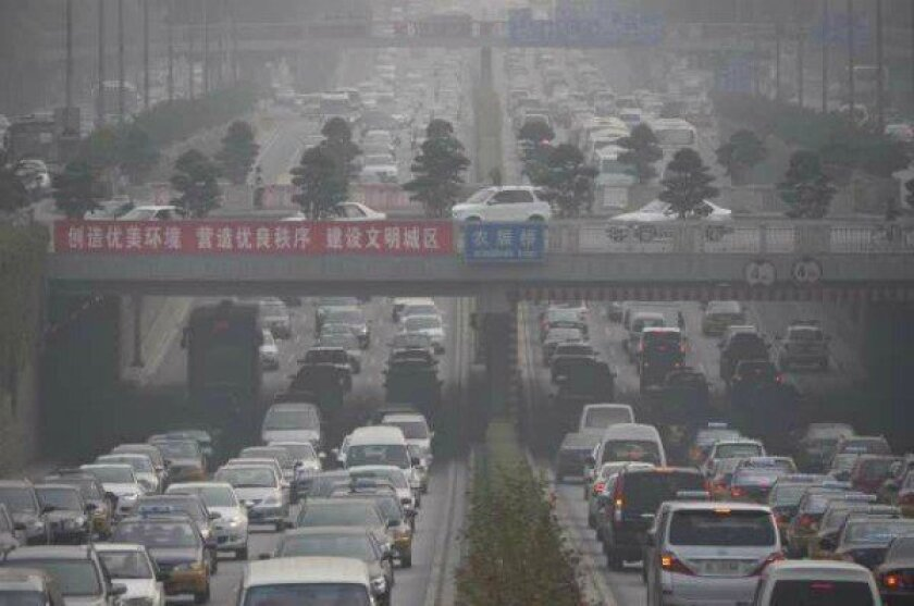 Poor air conditions prevail as traffic clogs the Third Ring Road in Beijing.