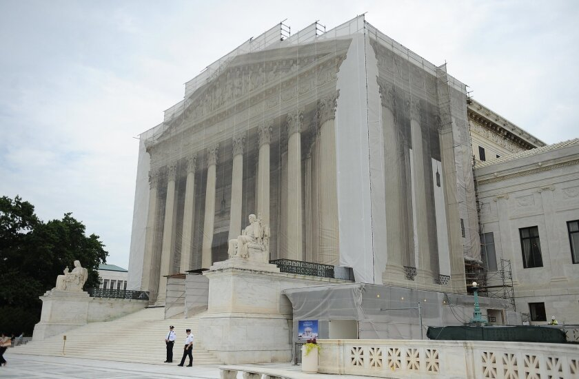 A full-size scrim imprinted with the U.S. Supreme Court building's facade covers scaffolding during renovation work at the Supreme Court in Washington, D.C.