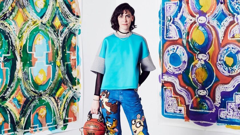 Artist Andrea Bergart's introduction to handbag design came through her experience assisting painter