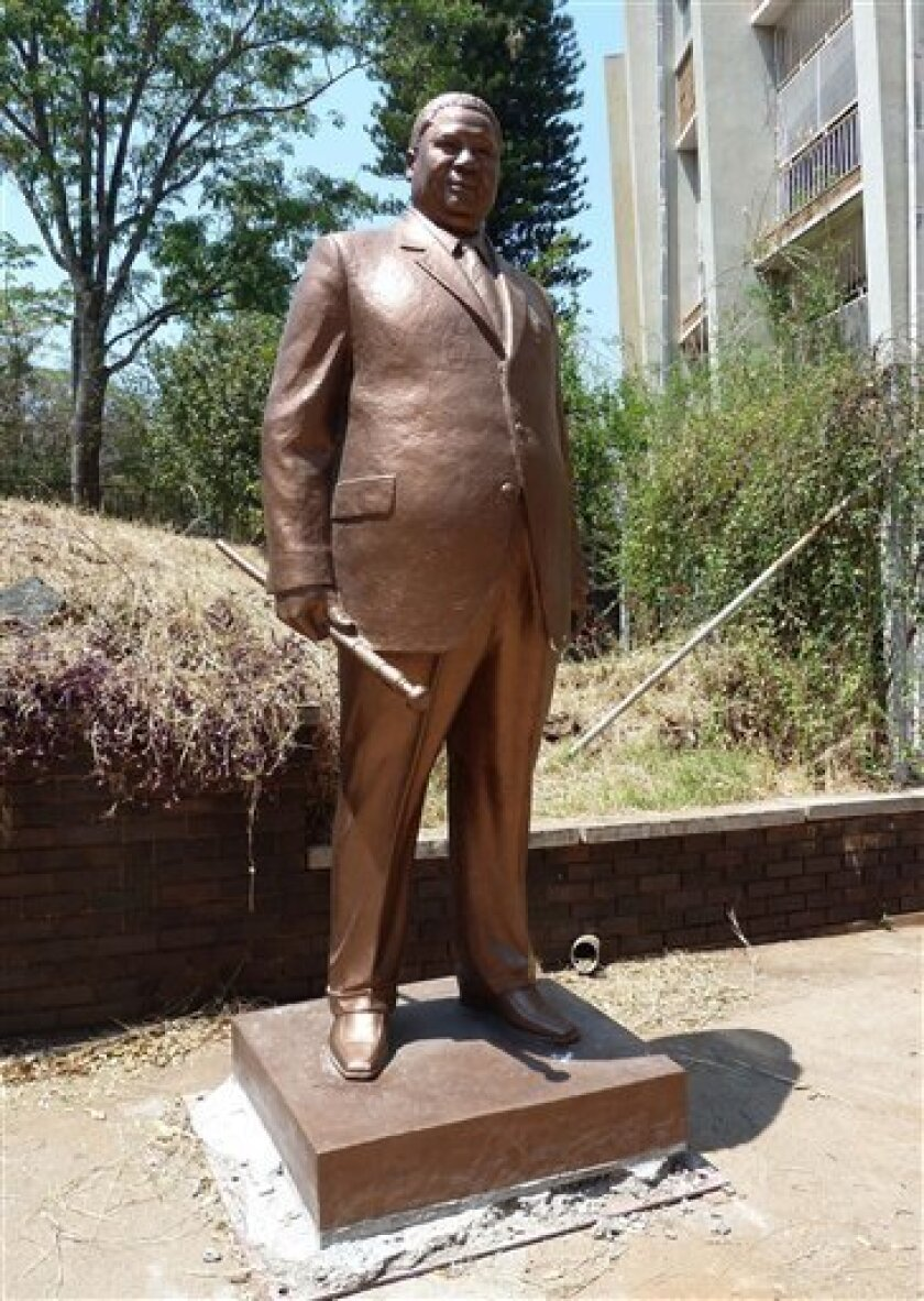 "In this photo taken Friday Sept 21, 2010 a statue of Joshua Nkoma in the grounds of the Museum in Bulawayo, Zimbabwe. Nkoma, a former guerilla leader known as ""Father Zimbabwe"" died in 1999 at the age of 82. (AP Photo)"