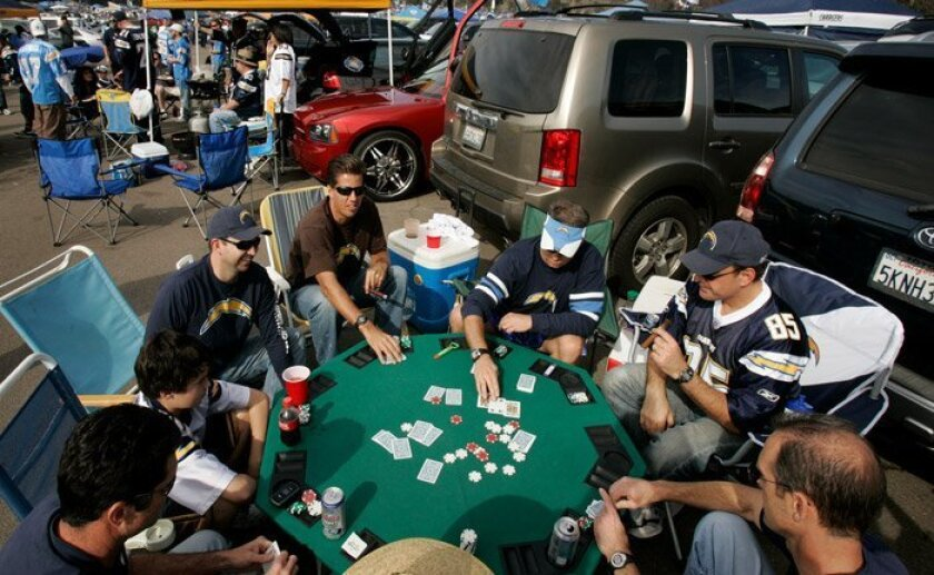 For eight tailgating Chargers fans Jan. 17, the game before the game was at a poker table.