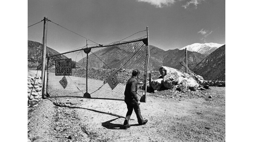 March 19, 1980: Los Angeles County road worker Bill Netzley opens  gate barring vehicles from the damaged final miles of Shoemaker Canyon Road.