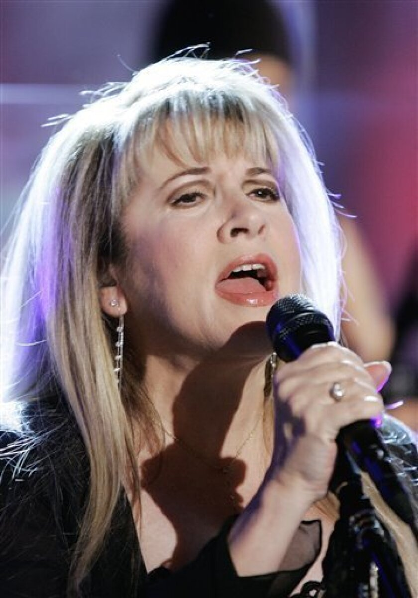 "In this March 30, 2007 file photo, Stevie Nicks performs on the NBC ""Today"" television program in New York. (AP Photo/Richard Drew, File)"