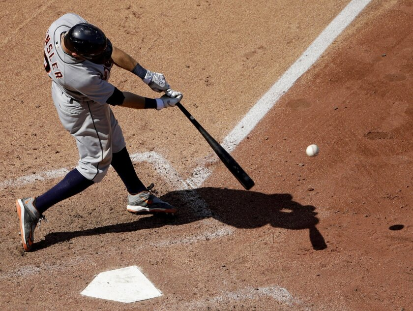 Detroit Tigers' Ian Kinsler hits an RBI single during the seventh inning of a baseball game against the Kansas City Royals, Sunday, Sept. 4, 2016, in Kansas City, Mo. (AP Photo/Charlie Riedel)
