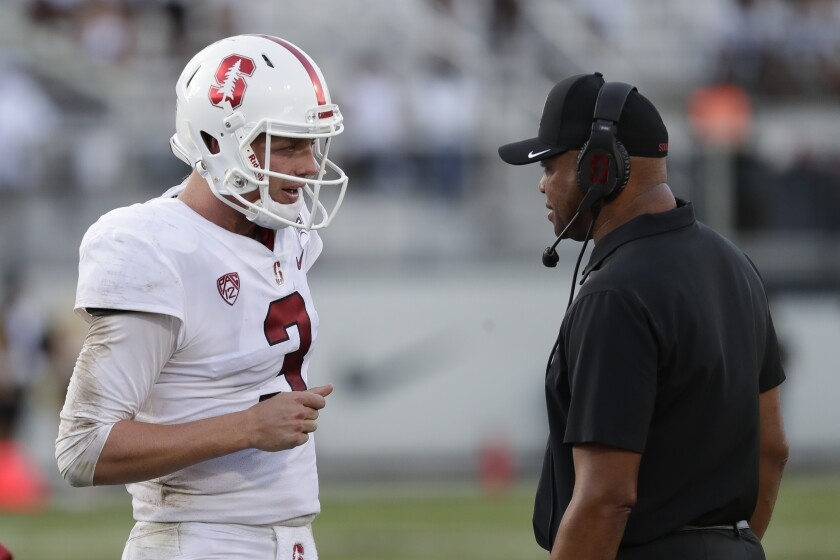 Stanford quarterback K.J. Costello, left, talks with coach David Shaw during Saturday's loss to Central Florida.