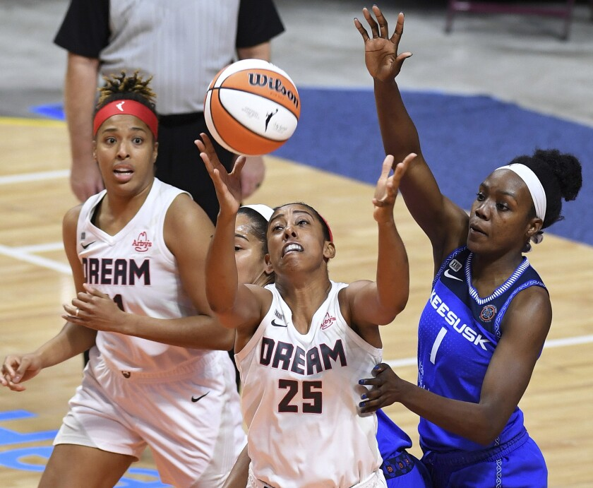 Atlanta Dream foreword Monique Billings (25) fights for control of the ball under pressure from Connecticut Sun defenders Beatrice Mompremier (1) and Brionna Jones, back, during a WNBA basketball game Friday, July 9, 2021, in Uncasville, Conn. (Sean D. Elliot/The Day via AP)