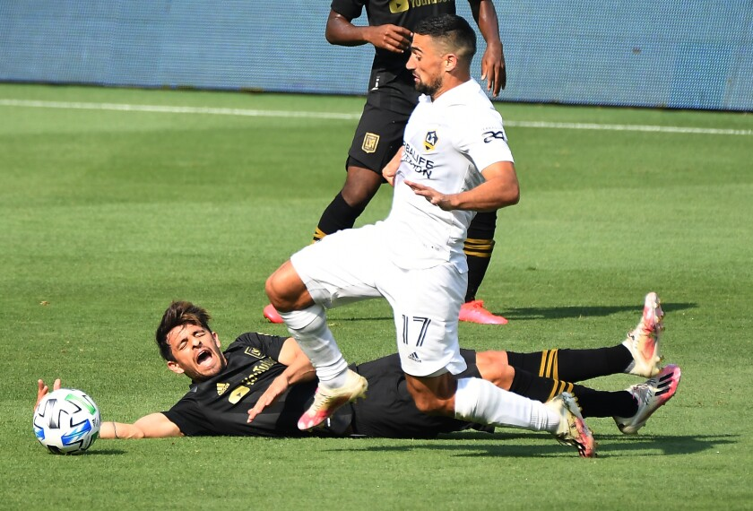 The Galaxy's Sebastian Lletget, right, collides with LAFC's Adrien Perez in the second half Aug. 22, 2020.
