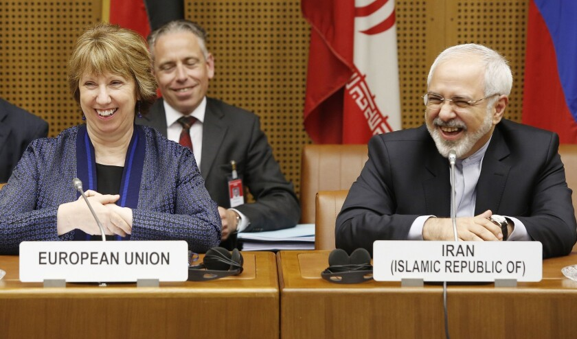 Vice President of the European Commission Catherine Ashton, left, and Iranian Foreign Minister Mohammad Javad Zarif smile while attending talks in Vienna aimed at reaching a deal on Iran's nuclear program.