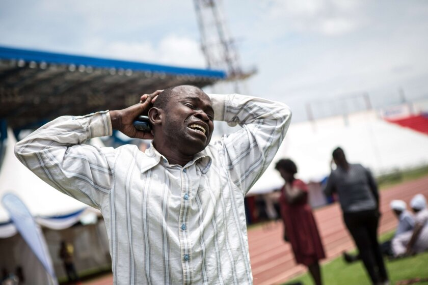 A man is overcome with grief Sunday at Nyayo Stadium in the Kenyan capital, Nairobi, after learning that a relative was killed by Somalia's Shebab Islamists during a siege at Garissa University College.